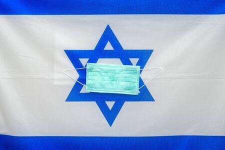 Coronavirus. Corona virus concept. Israel flag with medical mask to fight against Corona virus. Concept of protect against virus. Stockfoto