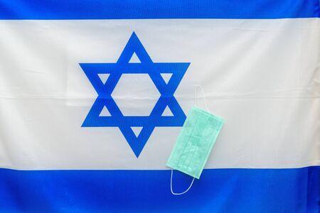 Coronavirus. Corona virus concept. Israel flag with medical mask to fight against Corona virus. Concept of protect against virus.
