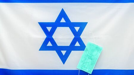 Coronavirus. virus concept. Israel flag with medical face mask to fight against Corona virus. Concept of protect against virus. Banner.