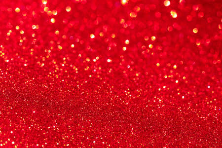 Red glitter texture Christmas abstract background. Defocused.