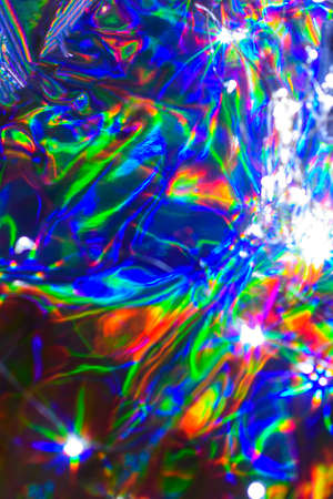 Holographic blurred iridescent abstract colorful festive background.