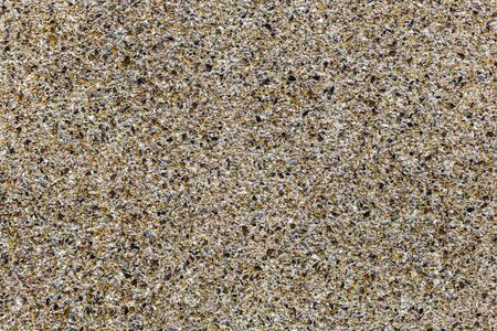 Stone Texture or Background with multicolored shards of glass. Yellow and brown colors.