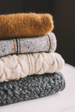 Cozy hand knitted knitwear on a dark background. Selective focus. Stock Photo