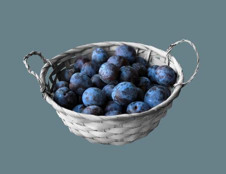 Ripe plum fruit in a wicker basket