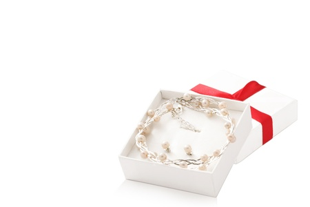 open white box with pearl necklaces and earrings inside isolated on white background Stock Photo