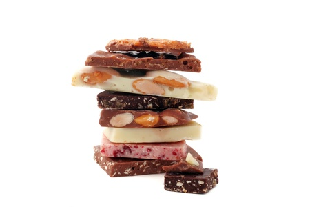 stack of pieces of colorful delicious chocolate of different sorts Stock Photo