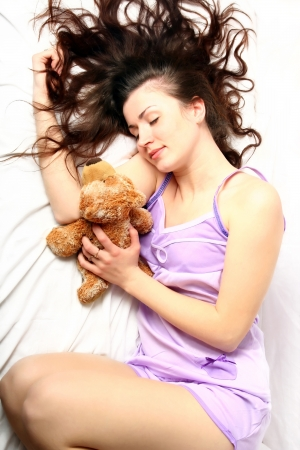 beautiful young woman in the morning in bed  photo