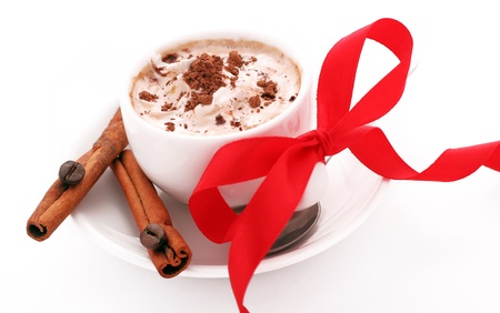 cup of coffee with cream, cinnamon and red bow Stock Photo