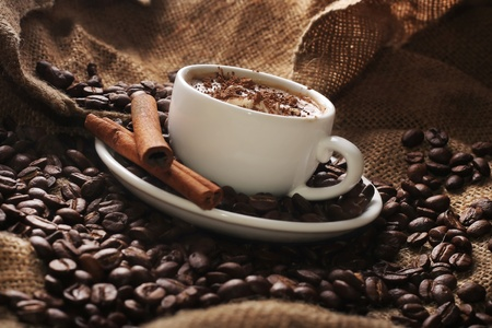 cup of coffee with cream and cinnamon