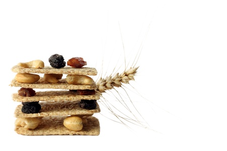 diet breakfast of crisp bread with nuts and raisins and cereals photo