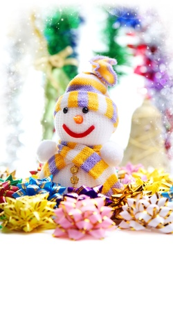 Colorful Christmas card with snowman and decorations photo