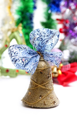 Christmas bell with ribbon on a colorful background photo