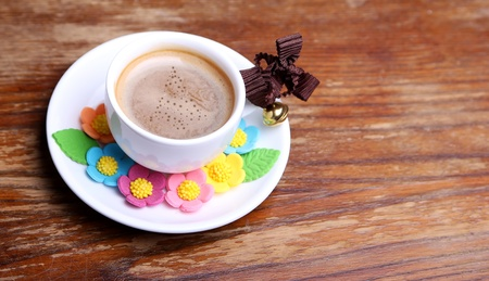 cup of coffee on the wooden background photo