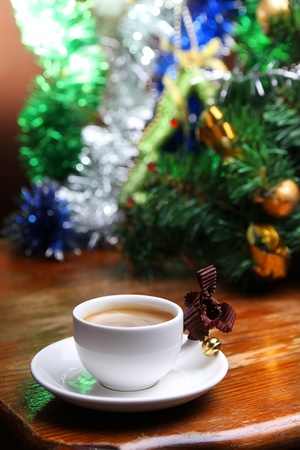 cup of coffee on the background of Christmas decorations photo