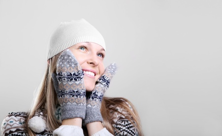 beautiful young smiling woman in a knitted sweater Stock Photo - 11392151