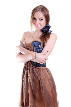 beautiful young woman in dress hugging herself with her hands Stock Photo