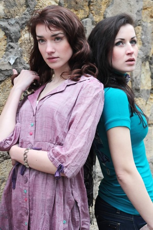 two beautiful fashionable girls outdoor Stock Photo