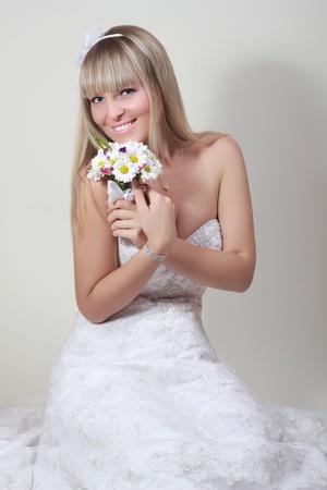 portrait of happy bride with a bouquet photo