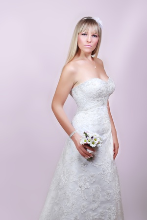 happy bride in white dress with a bouquet photo