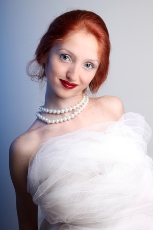 fashion portrait of a beautiful woman in image of bride photo