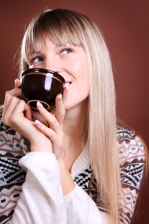 beautiful smiling woman with a cup of coffee