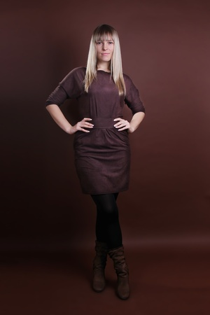 young woman in full length on a brown background