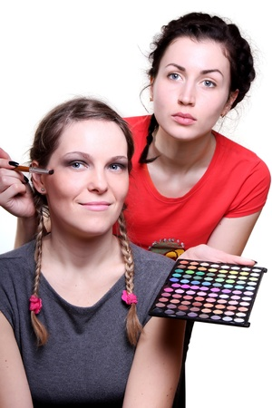 Beautiful Make Up Being Applied By Beautician At Salon photo