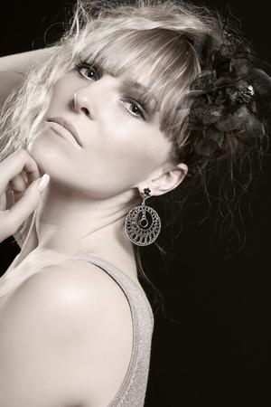 Retro styled woman on black background photo