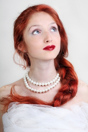 beautiful bride with long hair in a pearl necklace