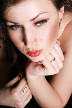 beautiful woman face with make-up closeup