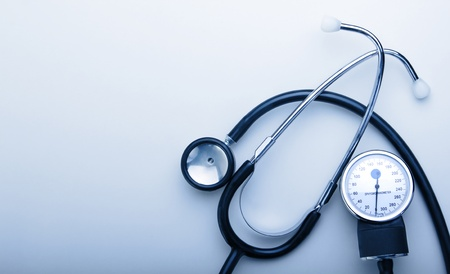 stethoscope on blue background with space for simple text Stock Photo