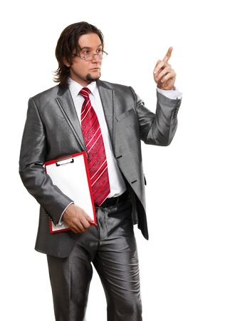 Portrait of a successful young business man pointing at something interesting against white background