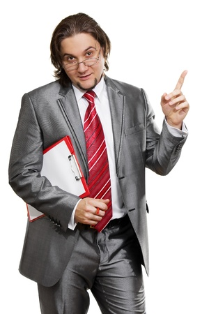 successful young business man pointing at something interesting against white background Stock Photo