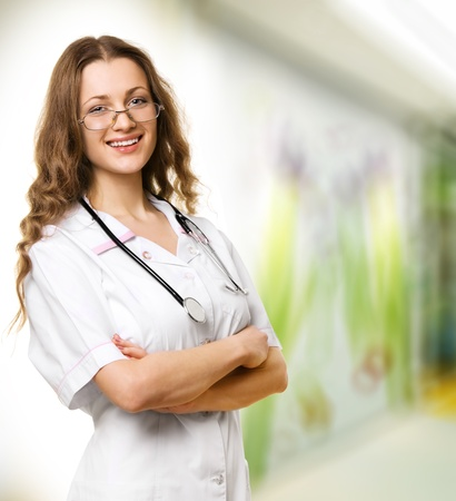 Close-up of a female doctor smiling with arms crossed Stock Photo - 12191640