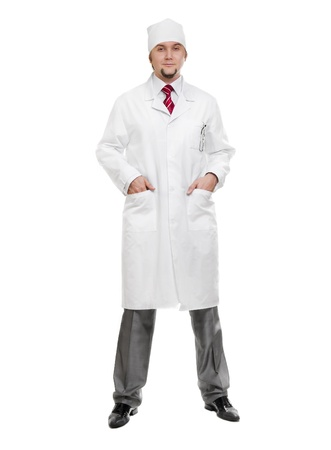 Male doctor standing against white background