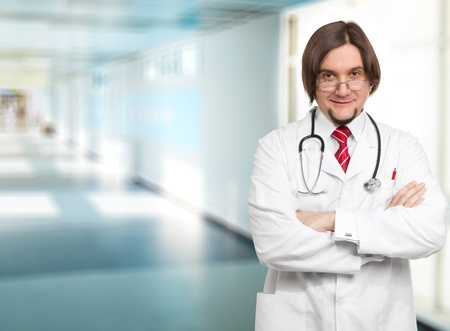 Close-up of a male doctor smiling with arms crossed Stock Photo - 12191637