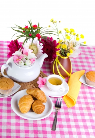 afternoon tea with croissants, cake and chocolate cookies photo