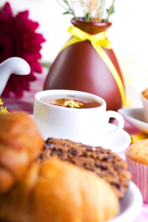 afternoon tea with croissants, cake and chocolate cookies