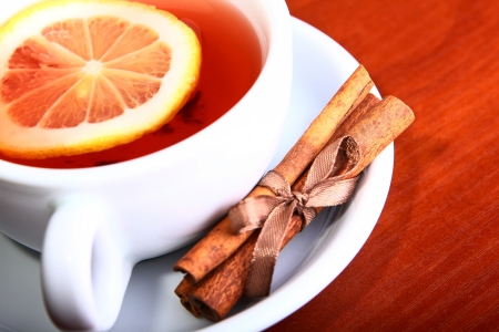 Cup of Hot Tea with Lemon on a wooden table