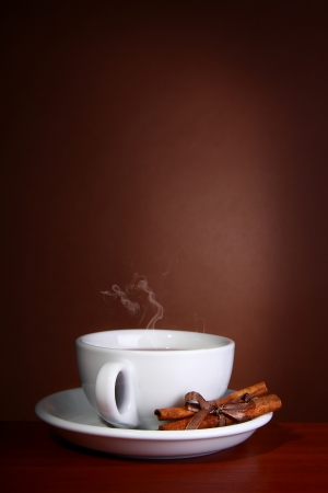 Cup of Hot Coffee with on a wooden table photo