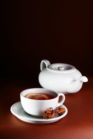 Tea with cinnamon in a dark brown interior