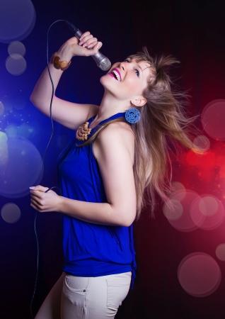 young beautiful girl dancing and singing