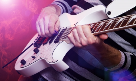 rockstar playing solo on guitar Stock Photo - 17441370