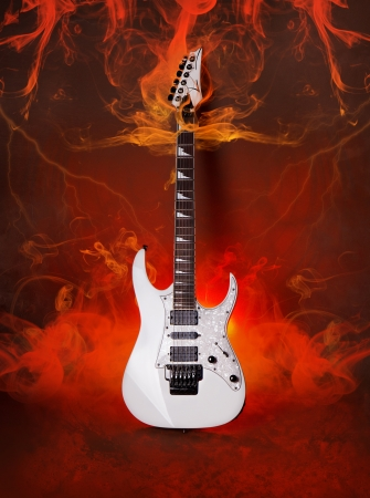 White Electric Guitar Burning  in Flame and smoke