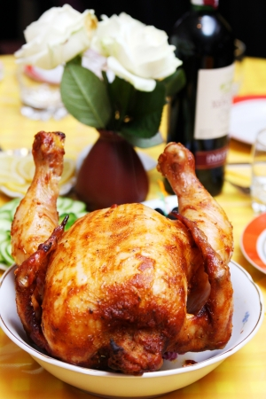 Roasted whole chicken with a delicious crust on the holiday table