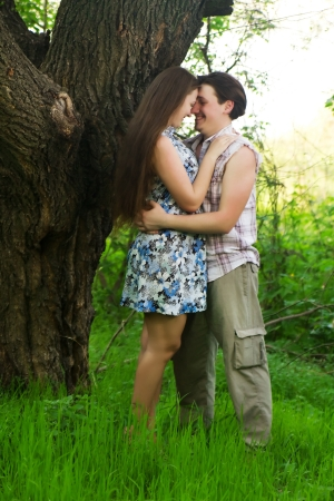two Summer Lovers Embracing in a park photo