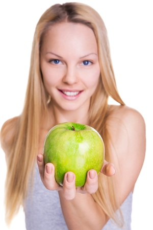 beautiful young woman offering green apple Stock Photo