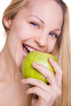 beautiful young woman with green apple on white background