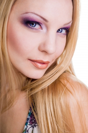 bright make-up of beautiful young blonde with longing eyes