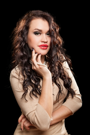 Fashion Brunette Beautiful Makeup and healthy dark curly Hair